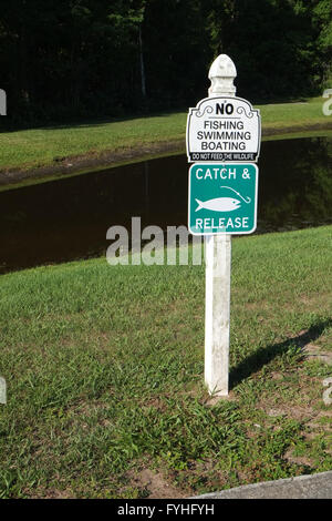 Sign beside a small lake in Florida, No Fishing, No Swimming, No boating, Catch and release. April 2016 - Stock Photo