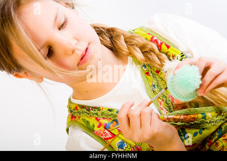 Young girl concentrated on painting - Stock Photo