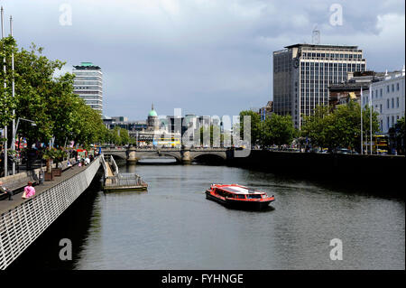 Boat tour on the Liffey river, O'Connell bridge and the Custom house, Dublin, Ireland - Stock Photo