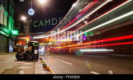 London, England - March 3, 2014: Traffic lit up at night on the Chak Farm Road in busy Camden Town, north London. - Stock Photo