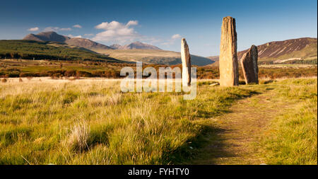 One of the array of Bronze Age stone circles on the plateau beneath the mountains at Machrie Moor on the Isle of - Stock Photo