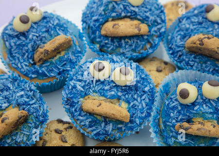Handmade coconut muffins with chocolate cookies - Stock Photo