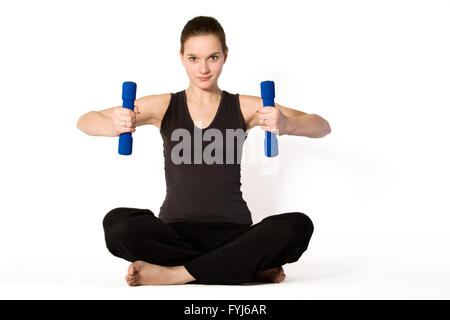 Young girl is concentrating on weights - Stock Photo