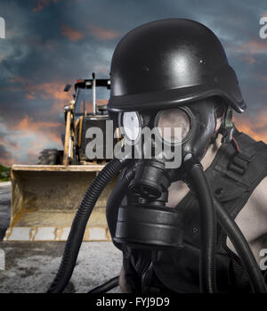 Pollution.Environmental disaster. Post apocalyptic survivor in gas mask - Stock Photo