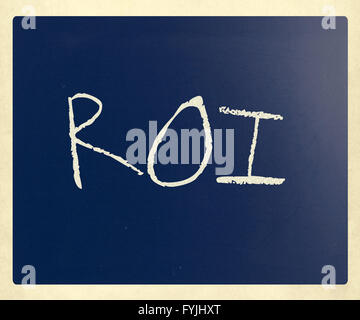 The word ROI handwritten with white chalk on a blackboard - Stock Photo