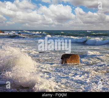 Sea foam shines on the sun. New quay in Tel Aviv - Stock Photo