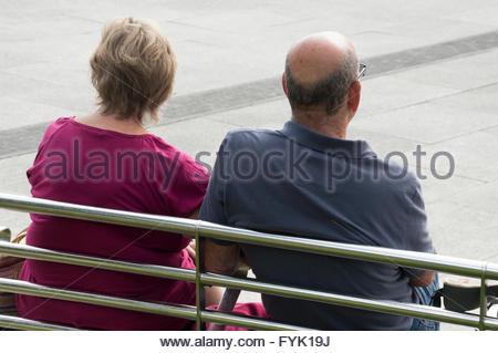 Couple sitting on a bench, Barnstaple, North Devon - Stock Photo
