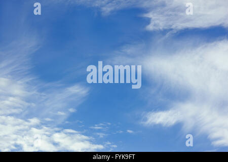 White stratospheric clouds on blue sky - Stock Photo