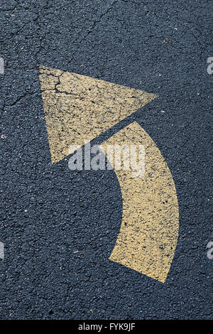 Arrow left turn sign on the road - Stock Photo