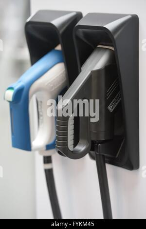 A energy service station for electronic cars at a stand of an energy fair, Germany, city of Hannover, 25. April - Stock Photo