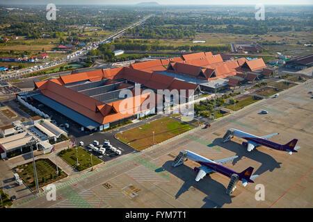Cambodia Angkor Air planes at Siem Reap International Airport, Siem Reap, Cambodia - aerial - Stock Photo