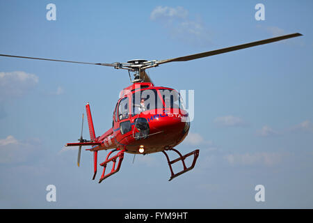 Helistar Eurocopter AS350B2 helicopter doing Angkor Wat flights, Siem Reap, Cambodia - Stock Photo