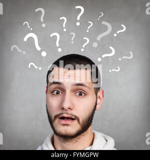 Handsome man has too many questions - Stock Photo