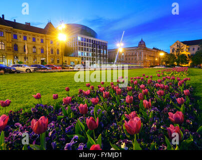 Zagreb Marshal Tito square. Art and Craft museum and new Music Academy with tulips in front. - Stock Photo