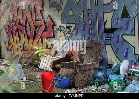 2 sofa chairs in an abandoned military base in The czech republic. On the walls colorful graffiti, next to 2 old - Stock Photo