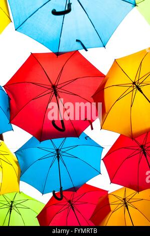 Many colorful umbrellas against the sky in city settings. Kosice, Slovakia. Color background