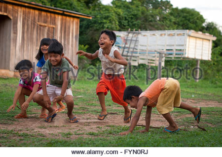 Surui children playing at Lapetanha in the '7th September Indian Reserve', Rondonia, Brazil. - Stock Photo