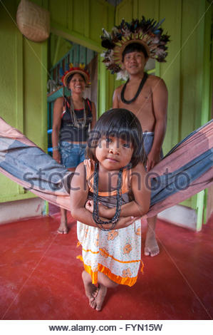 4 year old Soeytxer Surui with her father and mother at home in Lapetanha, Rondonia, Brazil at the '7th September - Stock Photo