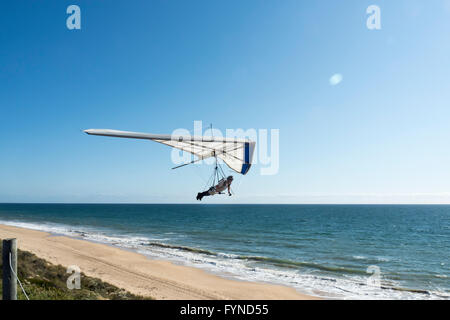 Close up of Hang Glider against Blue Sky over Bunbury Beach, Western Australia - Stock Photo