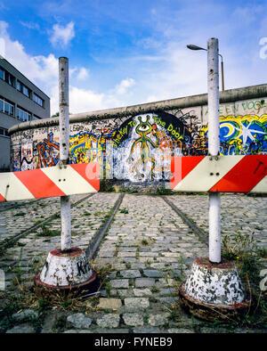 August 1986, Berlin Wall graffitis, tram track ending into wall, bollards, West Berlin side, Germany, Europe, - Stock Photo