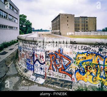 August 1986, Berlin Wall graffitis, death strip zone, East Berlin buildings, West Berlin side, Germany, Europe, - Stock Photo