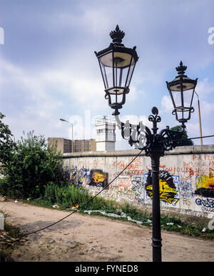 August 1986, Berlin Wall graffitis, street lamp, East Berlin watchtower, Zimmerstrasse street, Kreuzberg, West Berlin - Stock Photo