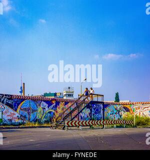 August 1986, Berlin Wall graffitis, young couple on observation platform, East Berlin watchtower, Kreuzberg, West - Stock Photo