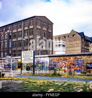 August 1986, leaving American sector warning sign, Berlin Wall graffitis, East Berlin watchtower, Zimmerstrasse - Stock Photo
