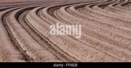 Precision farming using satellite navigation systems during planting and seeding using a seeder/planter with a tractor. - Stock Photo