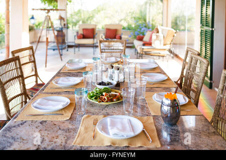 ... Set the table before the lunch in veranda of the Spanish home Mallorca - Stock & Table set for lunch in Spanish kitchen with blue pelmet on peach ...