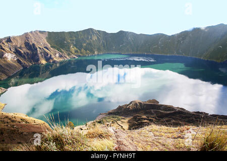 Quilotoa is a water-filled caldera that was formed by the collapse of the volcano following a catastrophic eruption - Stock Photo