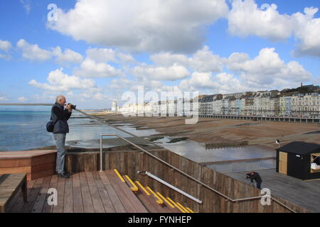 A VIEW OF HASTINGS SEAFRONT FROM HASTINGS PIER ON THE DAY OF IT@S RE-OPENING FOLLOWING RESTORATION - Stock Photo