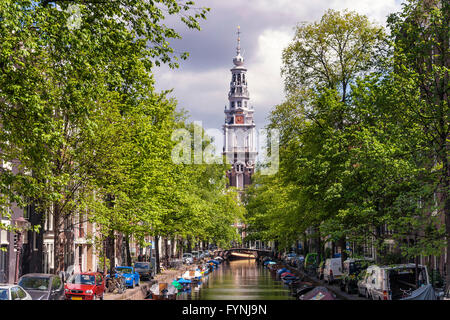 Westerkerke Church in Amsterdam viewed along the Prinsengracht Canal, Amsterdam, Netherlands - Stock Photo