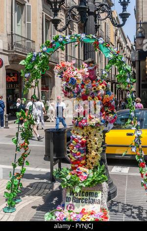 Human Statue with flowers, La Rambla, Ramblas, Barcelona - Stock Photo