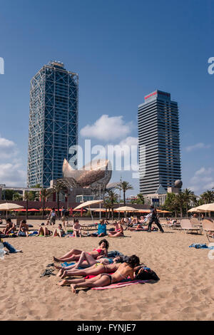 Platja de la Barceloneta Hotels Artssculpture  by Frank Gehry Passeig Maritim , beach, people, Barcelona, Spain - Stock Photo