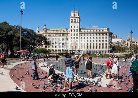 Plaza De Catalunya, Tourists with doves, Barcelona, Spain - Stock Photo