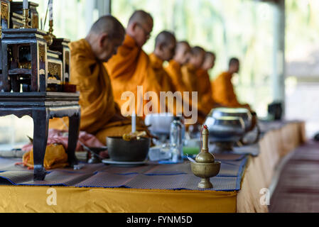 Buddhist monks performing prayers at The Heaven, Khao Lak, Thailand South East Asia - Stock Photo