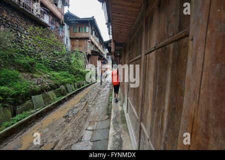Trekking throught the old Yao village of Dazhai, Guangxi Autonomous Region, China - Stock Photo