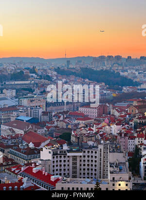 Airplane flying over the Lisbon city. Portugal - Stock Photo