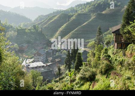 Dazhai village and rice terraces in morning light, Guangxi Autonomous Region, China - Stock Photo