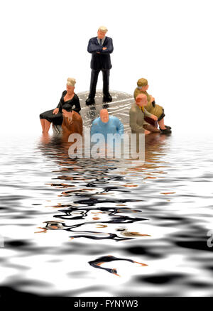 A miniature figurine man posing as a bank manager standing on some coins sinking into a digitally reflected pool - Stock Photo