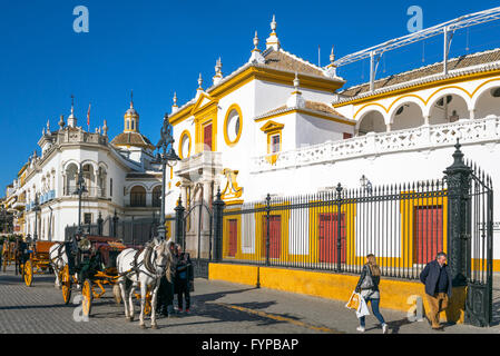 Spain, Andalusia, Seville, carriages in front of the Plaza de Toros (Bullring) and Real Maestranza de Caballeria - Stock Photo