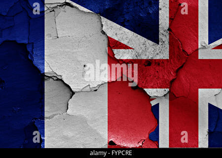 flags of France and UK painted on cracked wall - Stock Photo