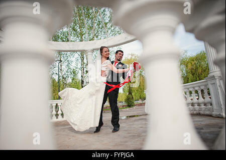 wedding couple under the arch - Stock Photo