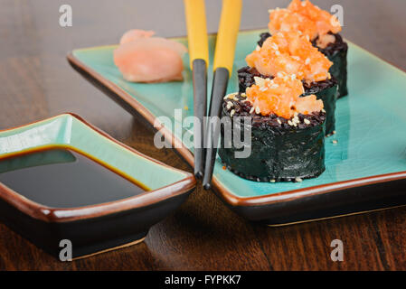 Sushi rolls served on blue plate - Stock Photo