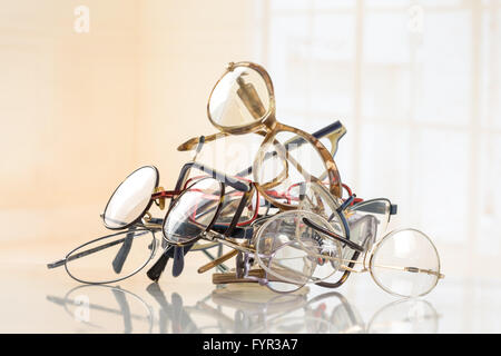 bunch of unneeded glasses  for donation to Third World - Stock Photo