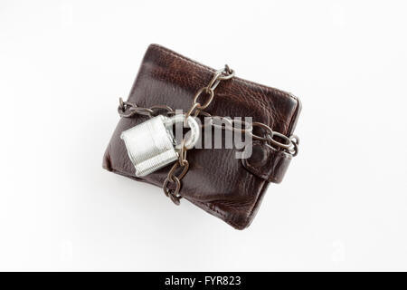 A leather wallet on a white background with a padlock and chain around it. - Stock Photo