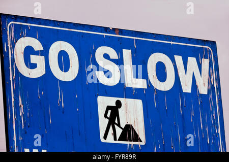 Go slow, Notice board - Stock Photo