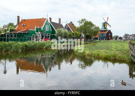 Amsterdam, Waterland district, Zaandam, typical country houses with mill - Stock Photo