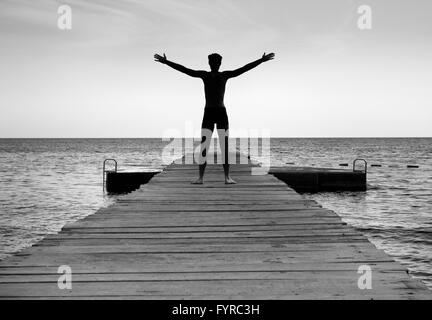 Free happy man enjoying life in nature - Stock Photo